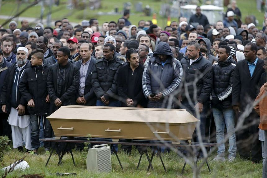 People attend the funeral of 15-year-old schoolboy Ahmed Hassan on Saturday, killed during an attack at Kronan school, in Trollhattan, Sweden.