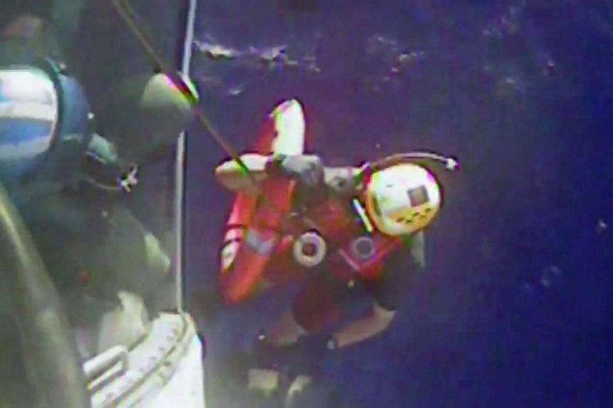 A video still shows the US Coast Guard recovering a life ring from the El Faro cargo ship on Oct 4, 2015.