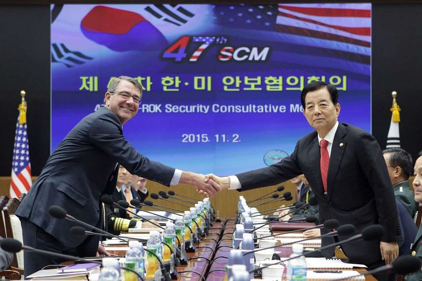 US Secretary of Defense Ashton Carter (left) shakes hands with South Korean Defense Minister Han Min Koo during the 47th Security Consultative Meeting (SCM).