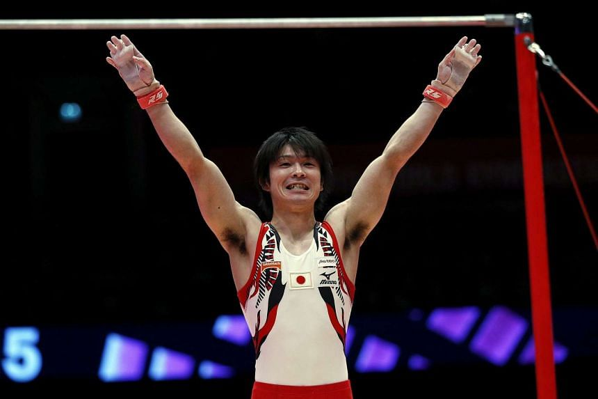 Japan's Kohei Uchimura reacts after his horizontal bar routine during the men's apparatus final.