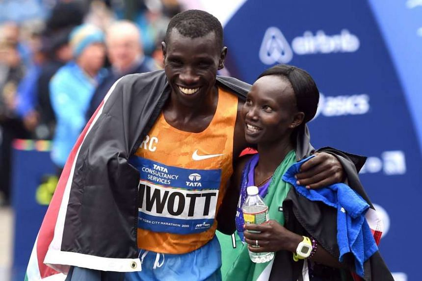 Stanley Biwott and Mary Keitany embrace after winning their divisions in the New York marathon.
