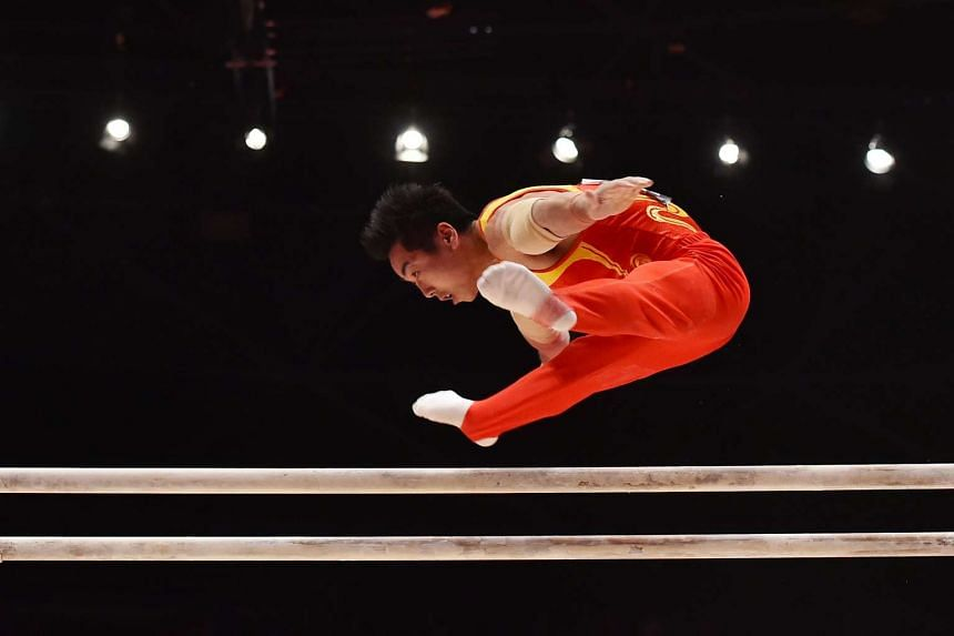 China's You Hao in action on the parallel bars on Oct 25, 2015.