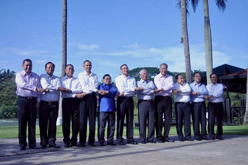 Singapore Defence Minister Ng Eng Hen (fourth from left) posing with Asean defence ministers and Asean Secretary General Le Luong Minh (right) at the ADMM retreat.
