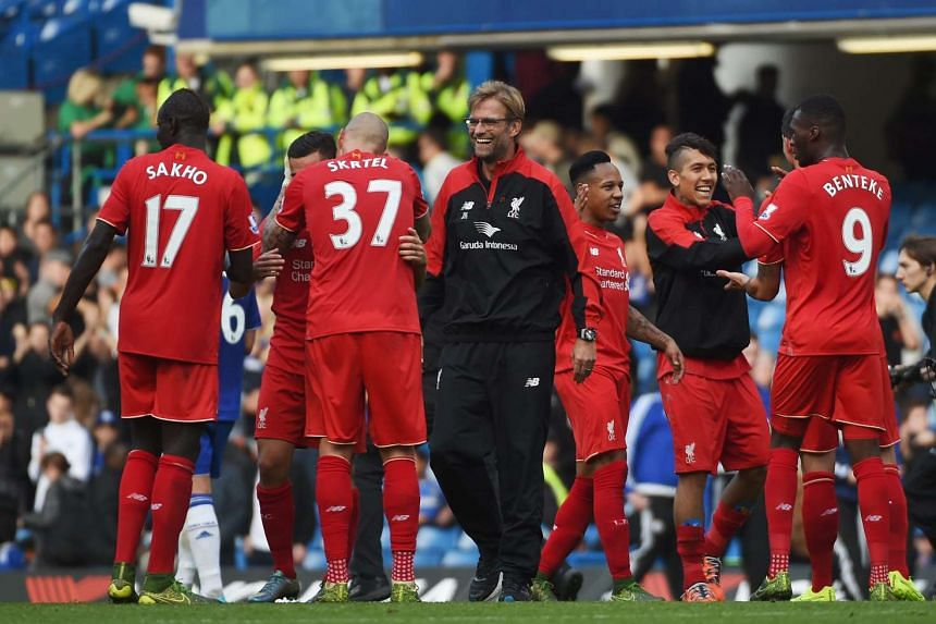 Liverpool manager Juergen Klopp congratulating Liverpool players at the end of the EPL match against Chelsea on Oct 31. 2015.