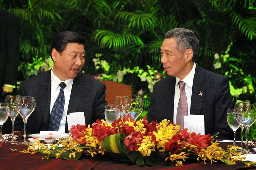 Xi Jinping with Prime Minister Lee Hsien Loong at a meeting at the Shangri-La Hotel on Nov 15, 2010.