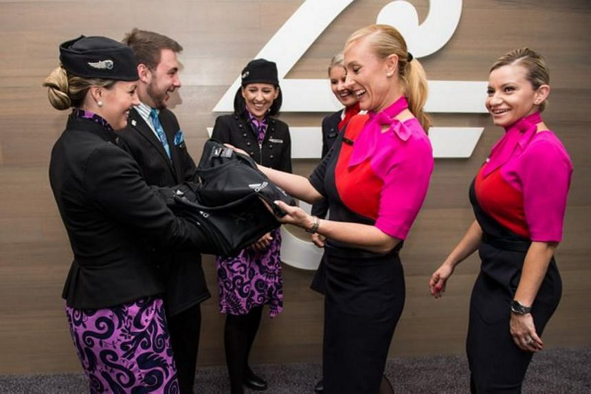 Qantas crew (right) accepting the All Blacks jerseys from Air New Zealand crew.