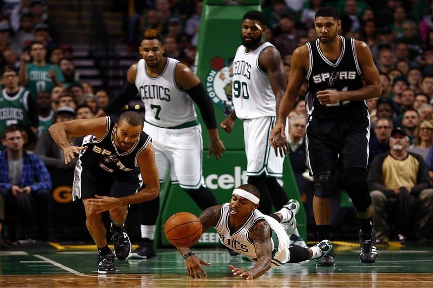 San Antonio guard Tony Parker (left) and Boston guard Isaiah Thomas diving for a loose ball. The Celtics tried to fight back from a 15-point deficit but could get no closer than four before losing 87-95.