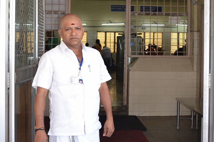 Mr Palani, a barber, at the entrance of the Kalyana Katta, or community hall, where people go to receive tonsure in Tirumala.