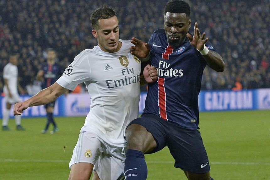 Jese Rodriguez (left), tussling with PSG defender Serge Aurier in their Oct 21 Champions League clash, has been fielded by Real Madrid, who are facing a mini injury crisis involving their top players.