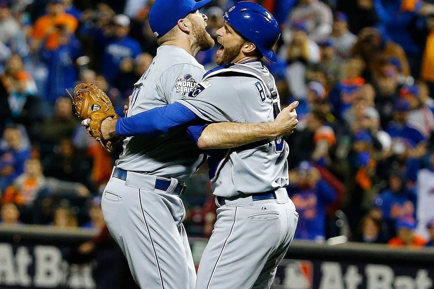 Wade Davis (left) and Drew Butera of the Kansas City Royals finally can celebrate, banishing the nightmare of a seven-game loss to San Francisco in last year's World Series.