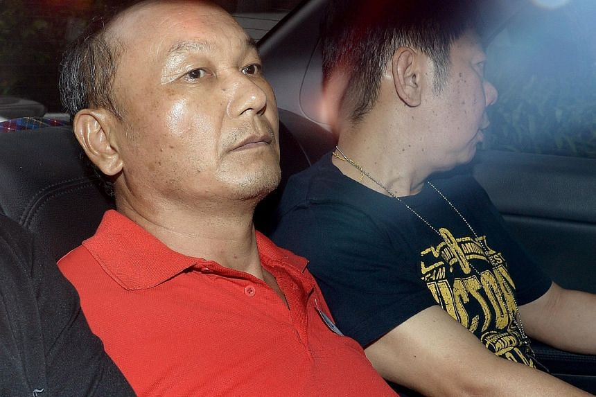 Chinese national Hu Ziqing (in red) was jailed 10 years yesterday after he pleaded guilty to a charge of culpable homicide for strangling his wife on Aug 8, 2013.
