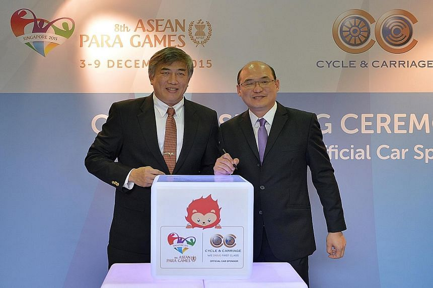 Lim Teck Yin (left), Singapore Asean Para Games Organising Committee chairman, with Eric Chan, C & C managing director (Singapore Motor Operations). The vehicle sponsorship for next month's event - the first time the Republic is hosting it - is worth