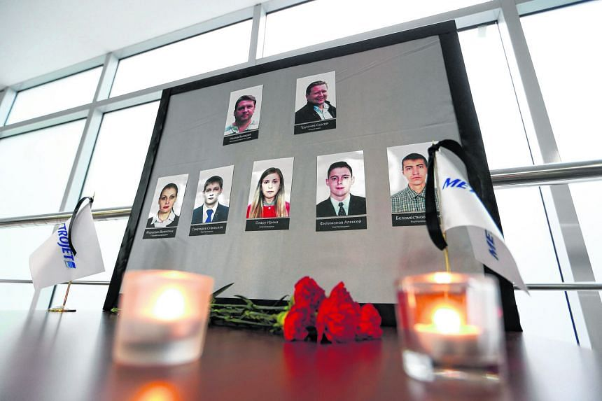 Flowers and candles at Kogalymavia's office in Moscow yesterday to mourn the crew killed in the crash in Egypt.