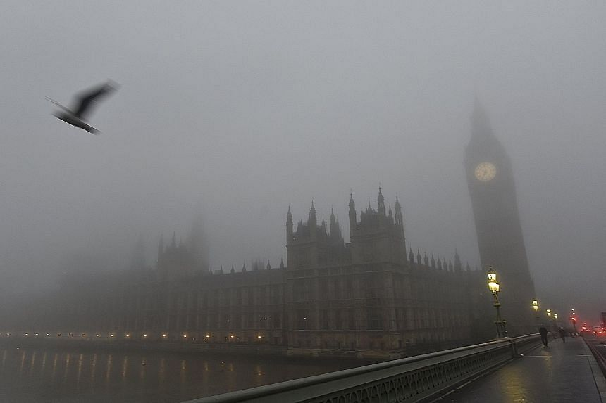 The Houses of Parliament in London shrouded in fog yesterday morning. British Airways cancelled more than 100 flights to and from Heathrow Airport and the Docklands' London City Airport, said The Independent. It added that London City was effectively