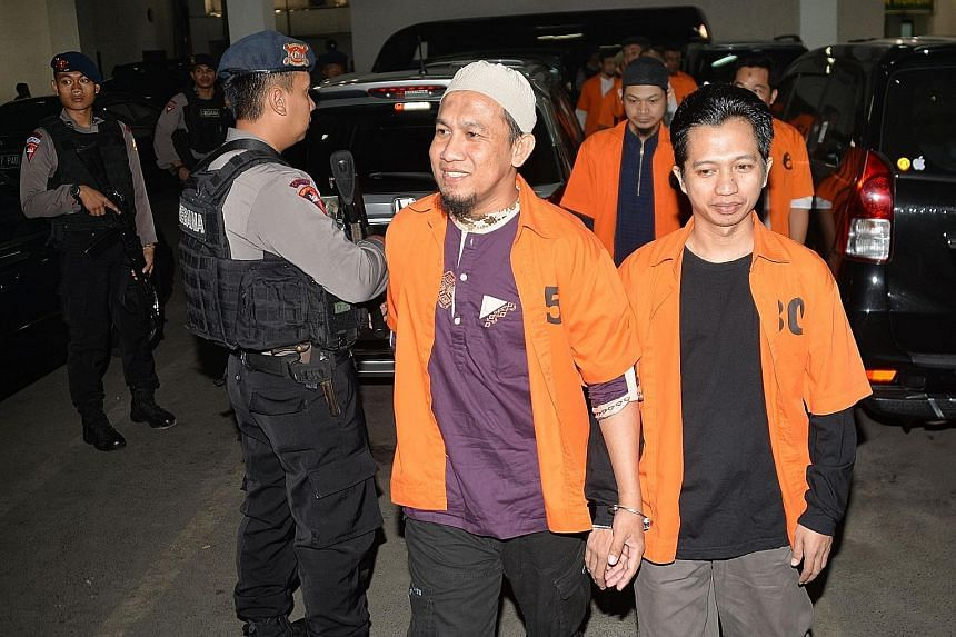 Indonesian terror suspects arriving at a West Jakarta court for their trial last month. Over 165,000 people are locked up in Indonesia's prisons. More than 250 of them are convicted of charges related to terrorism and are housed in 44 prisons across