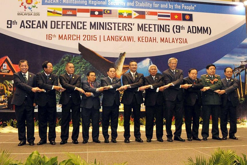Minister for Defence Dr Ng Eng Hen (fourth from right) taking part in the ASEAN Wave at the opening of the 9th ASEAN Defence Ministers' Meeting in Langkawi, Malaysia on Mar 16, 2015.