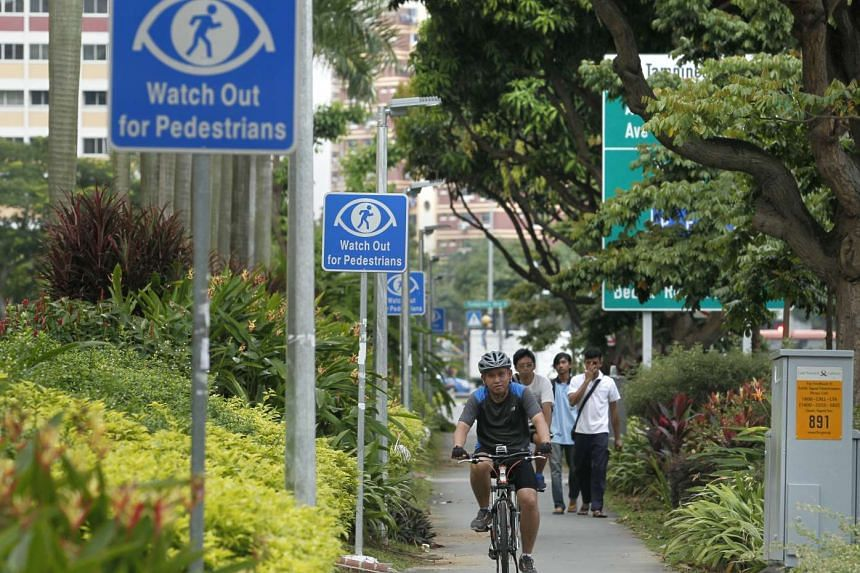 A cyclist riding on a bicycle path in Tampines.
