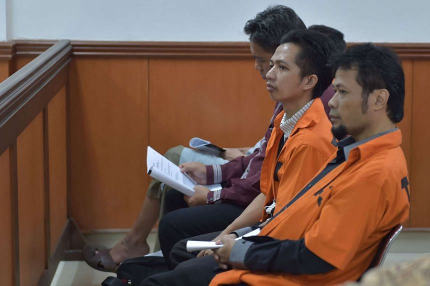 Indonesian meatball seller Ahmad Junaedi (second from right) waits in a court room prior to his trial at the West Jakarta court in Jakarta on Oct 12, 2015.