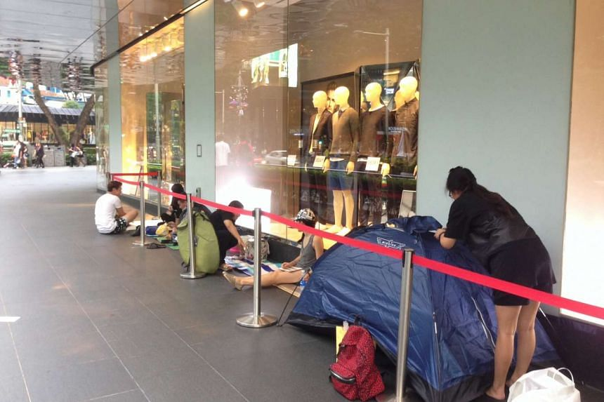 The queue outside the H&M flagship store at Orchard Building.