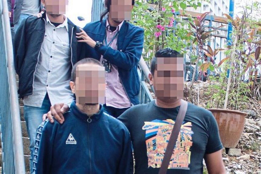 Police escorting two terror suspects picked up at KLIA when they arrived after serving sentences in Lebanon.