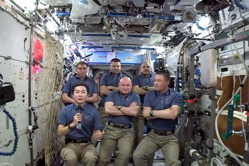 This NASA TV image obtained on Monday shows the ISS Expedition 45 Crew on the 15th Anniversary of the Start of Human Occupancy of the Space Station.