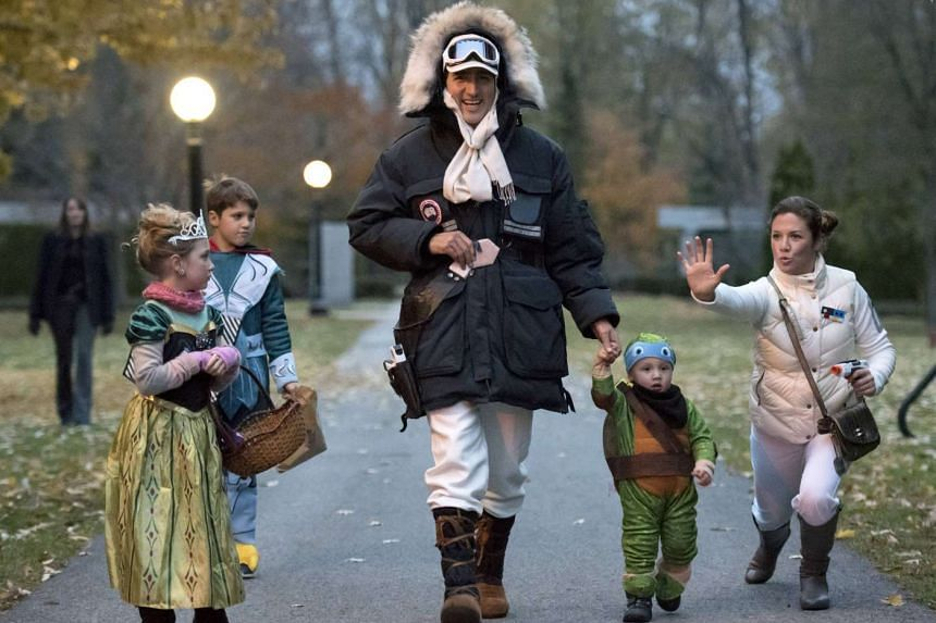 Canadian Prime Minister-designate Justin Trudeau dressed as Han Solo and his wife Sophie Gregoire (both above) as Princess Leia from Star Wars went trick-or-treating with their children.