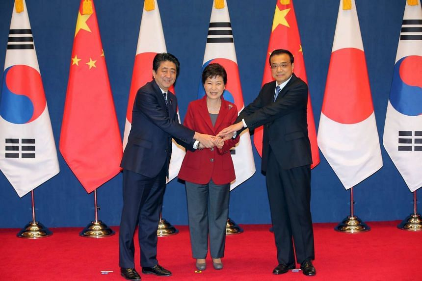 S. Korean President Park Geun Hye (centre) shaking hands with Chinese Premier Li Keqiang (right) and Japanese PM Shinzo Abe before the summit on Nov 1, 2015. PHOTO: REUTERS