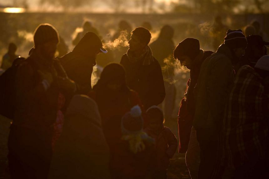 Migrants and refugees cross the Greek-Macedonian border.