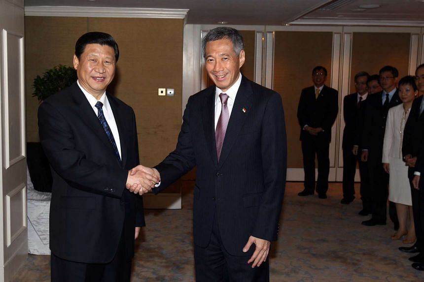 Chinese President Mr Xi Jinping (left) with Singapore Prime Minister Lee Hsien Loong in 2010.