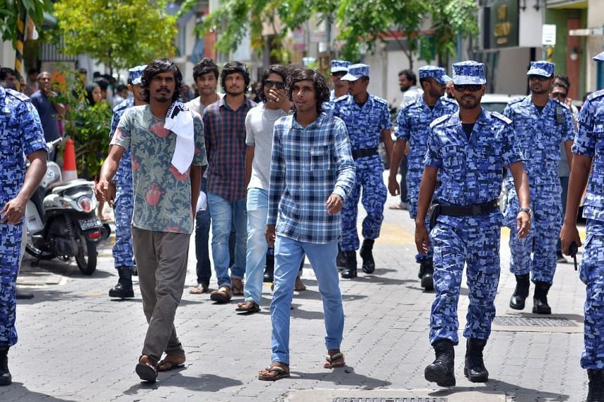 Maldives police officers patrol the streets of the capital Male on Oct 24, 2015.