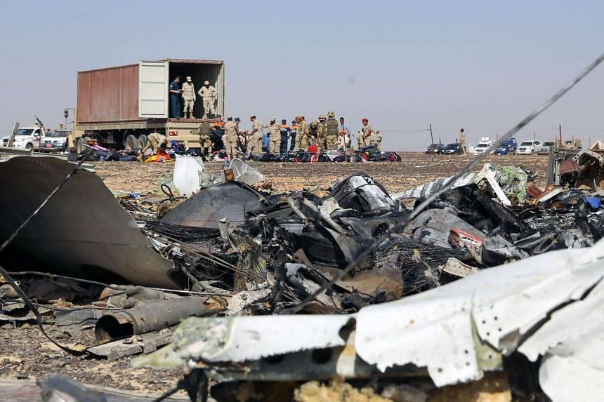 Russian emergency services personnel and Egyptian servicemen working at the crash site of the Russian jet in Egypt's Sinai Peninsula, on Nov 2, 2015.