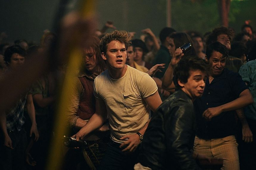 Jeremy Irvine (in white) in Stonewall, which tells the story behind the gay rights riots.