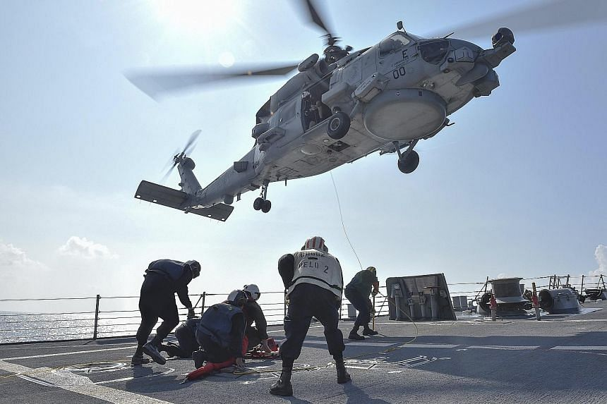 A medical training exercise on the deck of the USS Lassen in the South China Sea last Wednesday. Washington made its most significant challenge yet to China's claims last week by sending the guided-missile destroyer through territorial limits China a