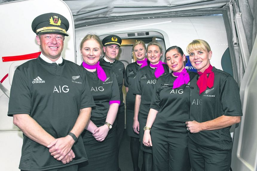 Qantas crew sportingly honour their bet.