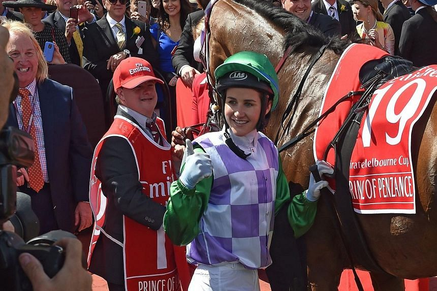 Michelle Payne became the first female jockey to win a Melbourne Cup on Prince of Penzance in Melbourne yesterday.