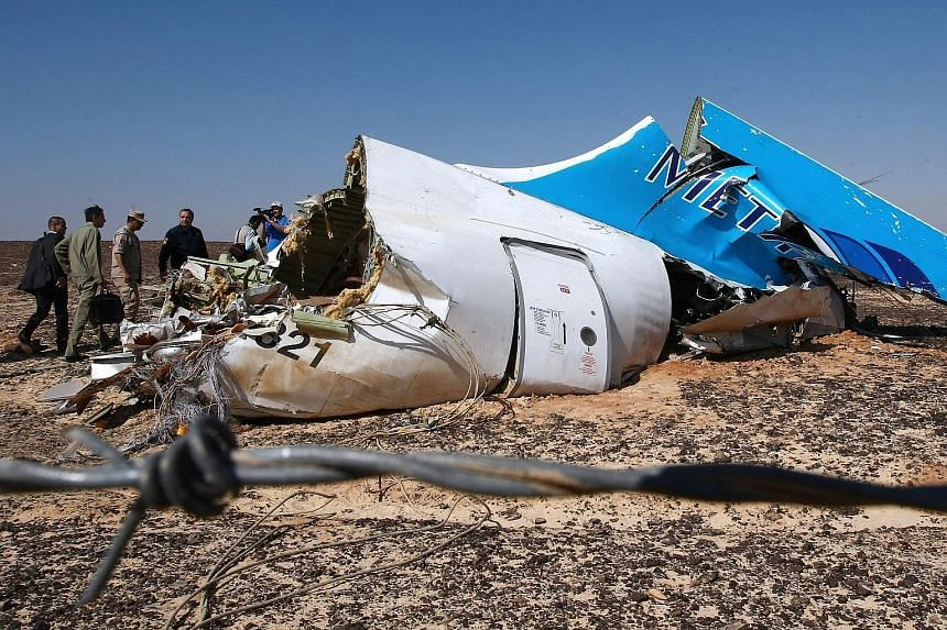 Officials examining the wreckage of the Russian Airbus plane at the site of the crash in Sinai, Egypt, on Sunday. The 18-year-old plane had previously been flown by a string of other airlines.