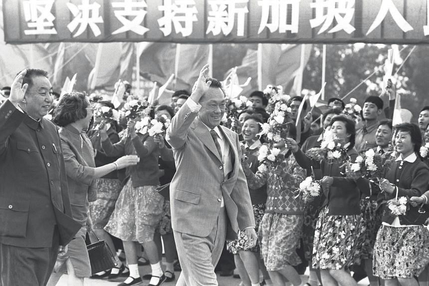 Then Singapore Prime Minister Lee Kuan Yew (centre), his wife Kwa Geok Choo (second from left) and Chinese Premier Hua Kuo-feng (left) waving during Mr Lee's visit to China in May 1976.
