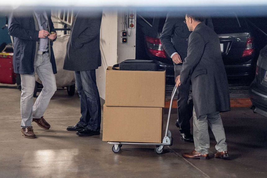 Investigators of the tax office move boxes of files in the garage of the German Football Federation (DFB).