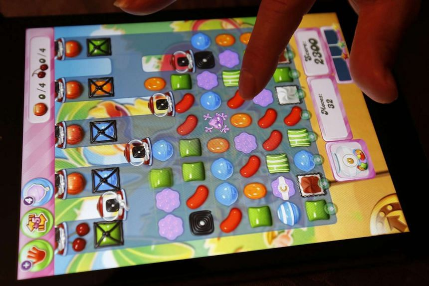 King Digital Entertainment's Candy Crush Saga is seen being played on an Apple iPad Mini the day Activision Blizzard announced it will buy King Digital.
