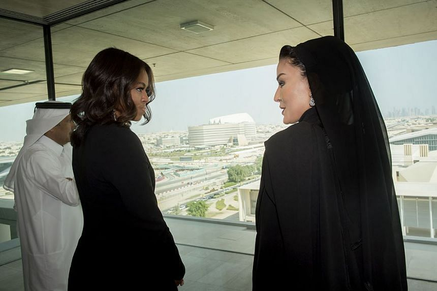 US First Lady Michelle Obama (left) meeting with Her Highness Sheikha Moza bint Nasser, Chairperson of the Qatar Foundation for Education, Science and Community Development in Doha on Tuesday.