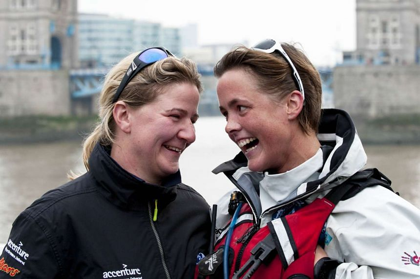 British adventurer Sarah Outen (right) and her partner Lucy on the River Thames on Monday, as Sarah celebrates completing more than four years rowing round the world