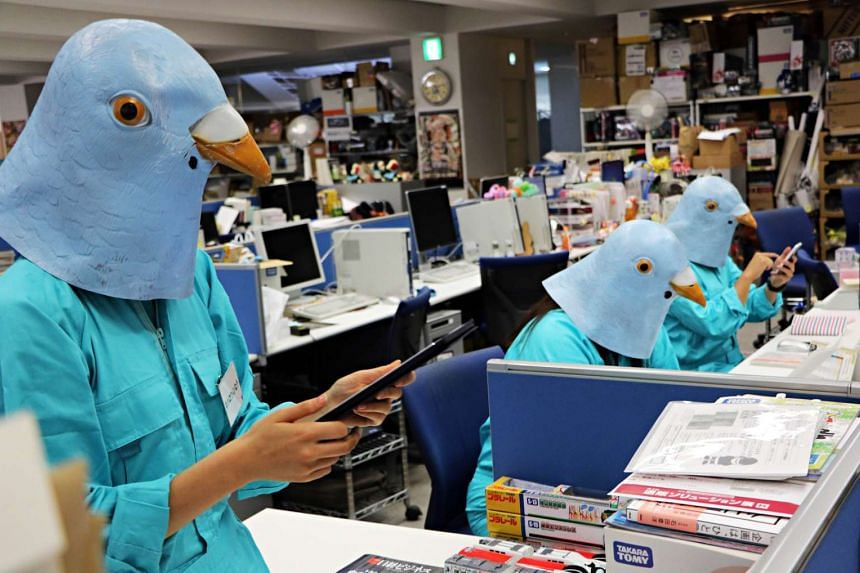 Employees of Japan's Tomy toy company dressed as Twitter birds work at their desks during the company's Halloween Day event  in Tokyo last week.
