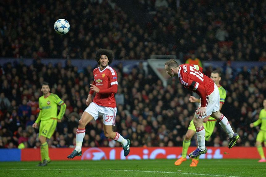 Rooney (right) scores the match's only goal.