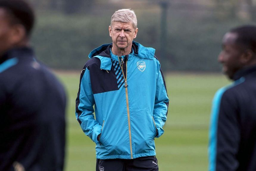 Arsene Wenger leads his team's training session at Arsenal's training complex.