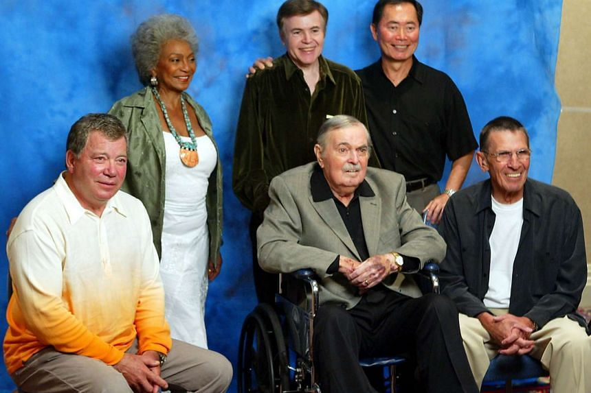 Cast of the original series of Star Trek (left to right) William Shatner, Nichelle Nichols, Walter Koenig, George Takei, Leonard Nimoy pose with James Doohan during a photo shoot at the Beam Me Up Scotty...One More Time, The James Doohan Farewell Sta