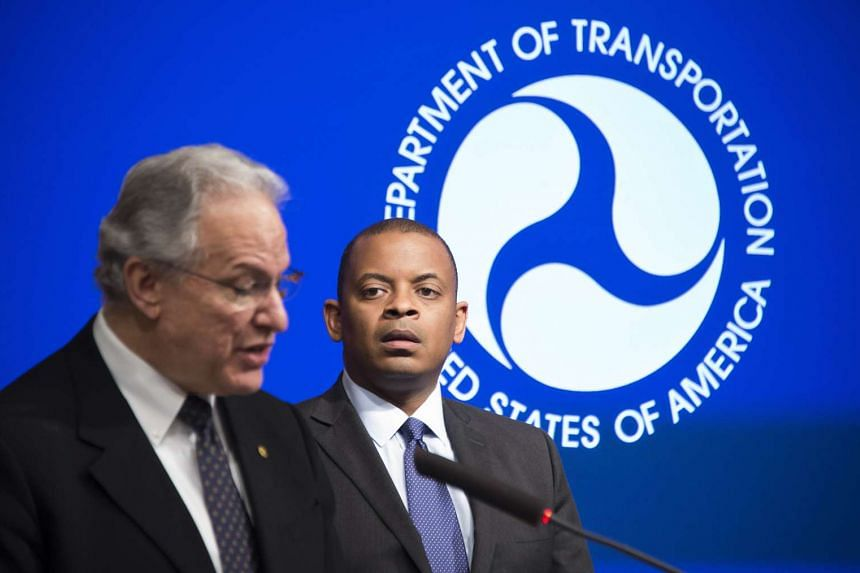 US officials Anthony Foxx (right) and Mark Rosekind announce actions taken against Takata.
