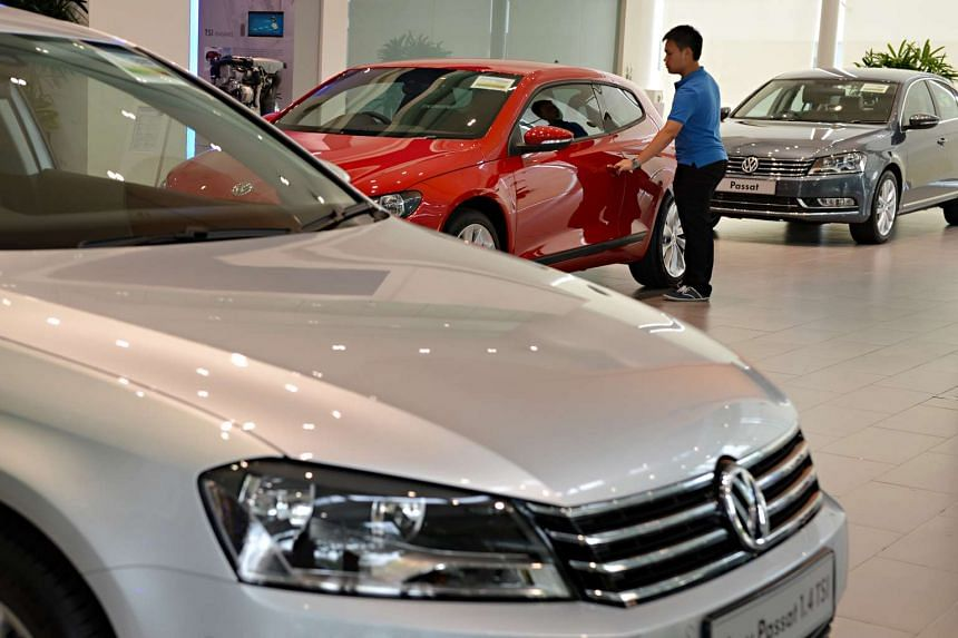 A visitor checking out a car at the Volkswagen Centre showroom in Singapore.