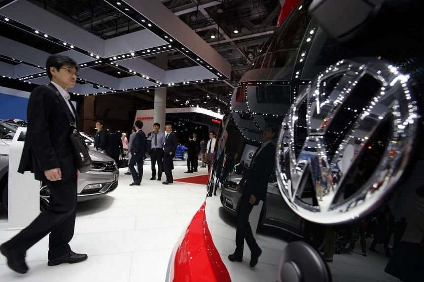 A visitor walks past a Volkswagen vehicle at the 44th Tokyo Motor Show.