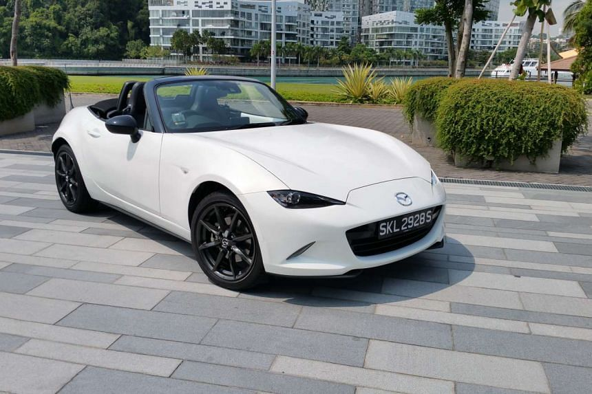 The manual Mazda MX-5 delivers better performance than the automatic version, but the automatic drives and sounds better.