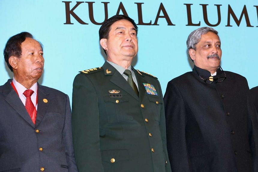 China's Minister of National Defence Chang Wanquan (centre), India's Defence Minister Manohar Parrikar (right) and Cambodia's Defence Minister Tea Banh posing for a photo at the Asean Defence Ministers Meeting in Kuala Lumpur on Nov 4.